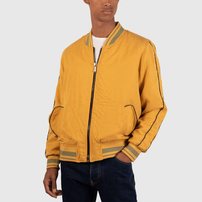 Yellow bomber with side pockets and inimigo back embroidery.