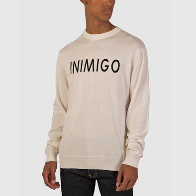 Beige knit with inimigo fronto logo in black.