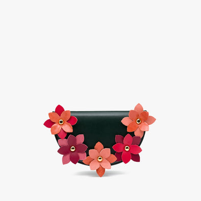 Half-moon shaped clutch in green leather with five decorative leather flowers in combinations of red, coral, pink, burgundy