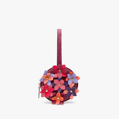 Circular clutch in burgundy leather with wrist handle and leather flower appliques in coral,lilac,purple,pink,red and orange