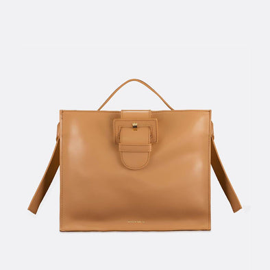 Beige leather handbag with a detachable strap to use as a shoulder bag.