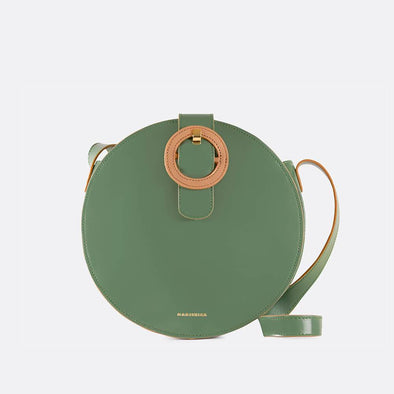 Sage green and camel round leather shoulder bag with the brand's signature buckle.