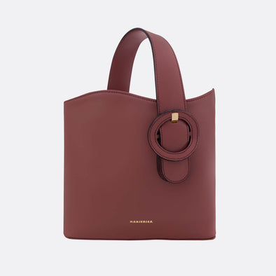 Bordeaux bag with a detachable strap.
