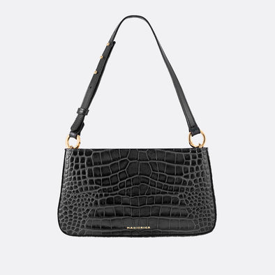 Handmade mini shoulder bag with engraved crocodile texture in black and adjustable black strap.