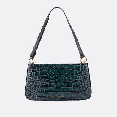 Handmade mini shoulder bag with engraved crocodile texture in green and adjustable black strap.