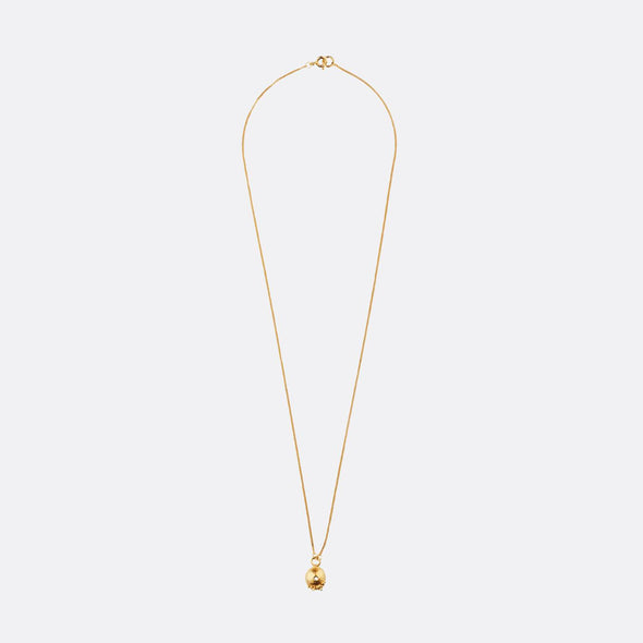 Golden necklace with oval shape and small oval textures.