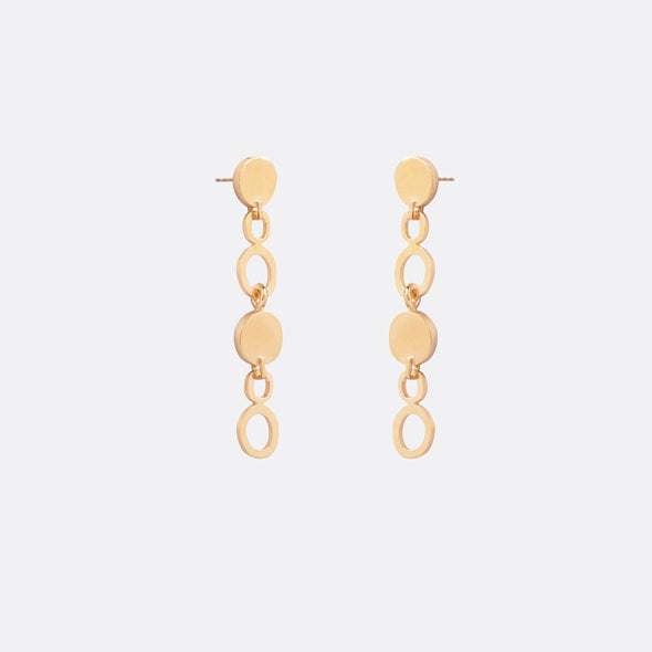 Golden long earrings with hoop shapes.