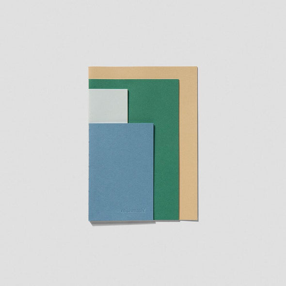 Multicolored side stitched notebook with four different paper sizes.