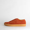 Rust suede calf leather sneakers with a stitched plain rubber cup sole, shock proof innersole and cotton laces.