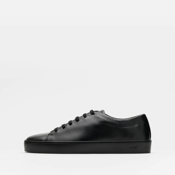 Black minimalist lace-up sneakers in white calfskin leather with ruber sole.