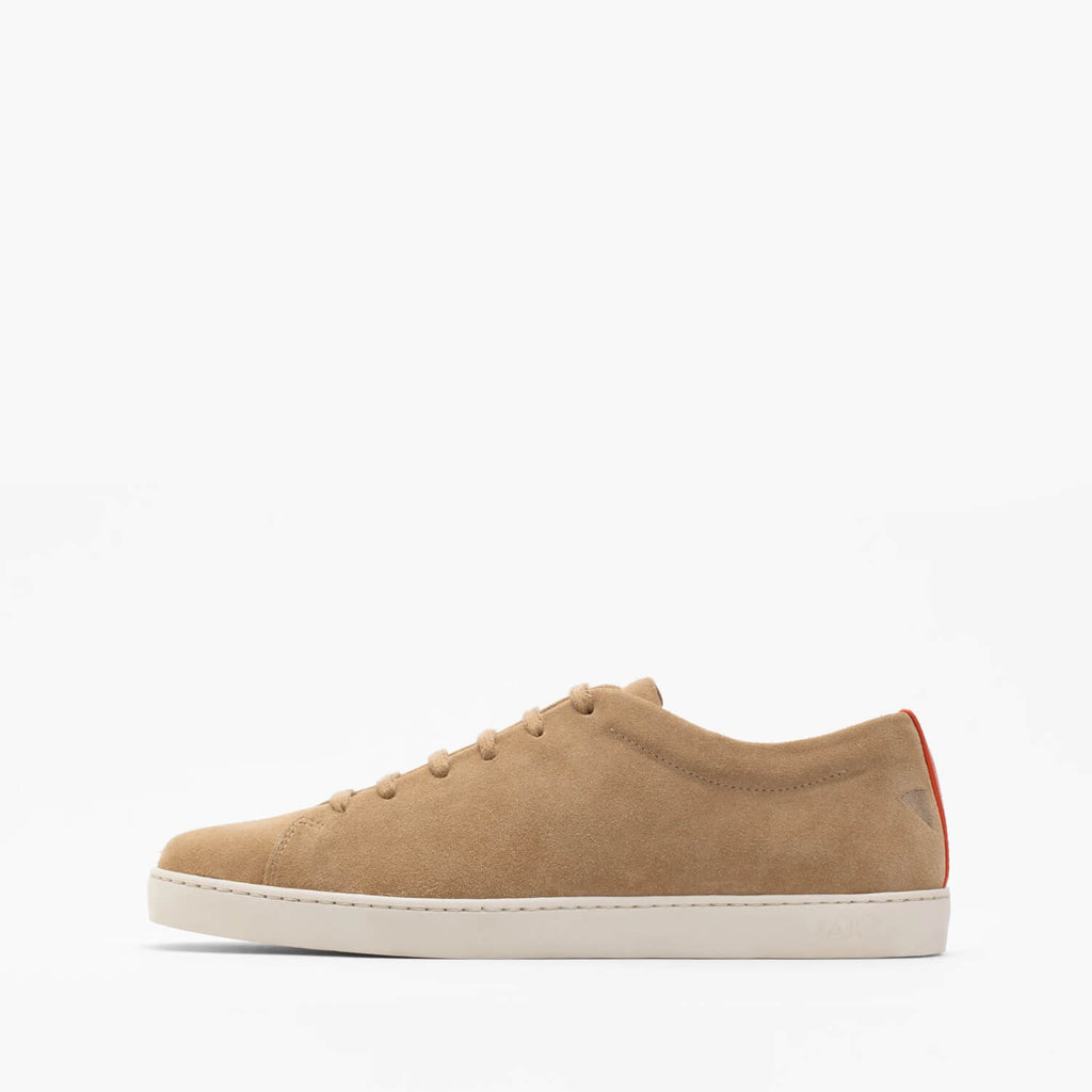 Beige minimalist lace-up sneakers in suede with slim ruber sole.