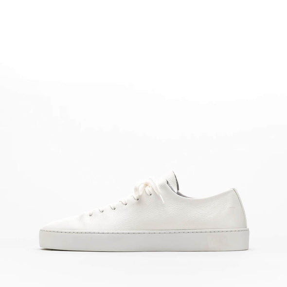 One piece white leather sneakers with a stitched plain rubber cup sole.