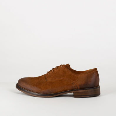 New progressive derby shoes in a tan color.