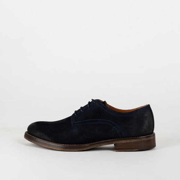 New progressive derby shoes in a navy blue color.