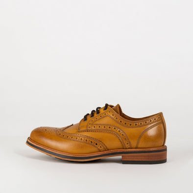 Tan colored noble designer derbies in burnished leather.