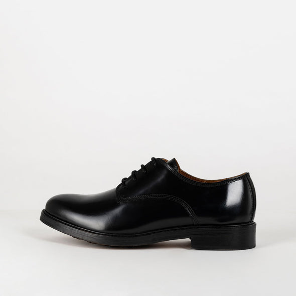 New progressive black leather derbies.