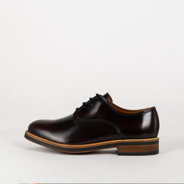New progressive ox-blood leather derbies.