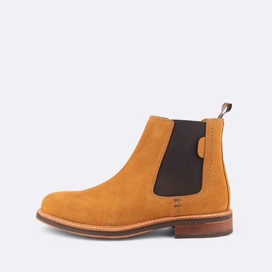 Brown suede chelsea boots with elastic on the ankle.