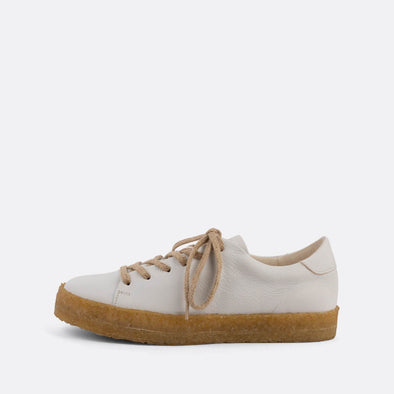 White casual derbies with a front lace-up closure and an almond-shaped toe.