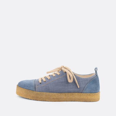 Light blue casual derbies with a front lace-up closure and an almond-shaped toe.