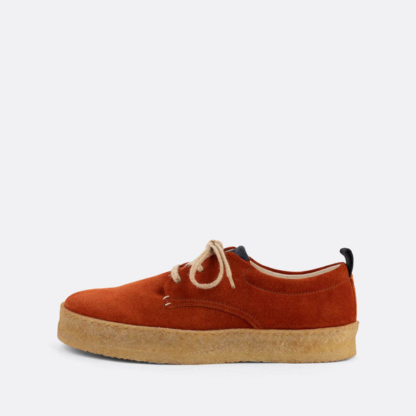 Casual derbies with brick suede uppers and natural crepe sole.