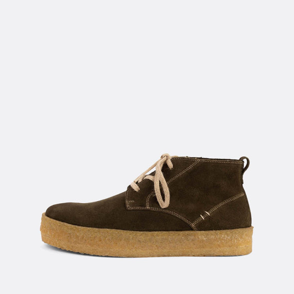 Casual chukka boots featuring olive suede uppers and natural crepe sole.