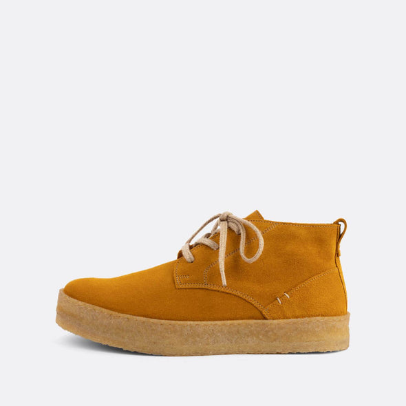 Casual chukka boots featuring ocre suede uppers and natural crepe sole.