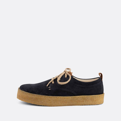 Casual derbies with navy blue suede uppers and natural crepe sole.