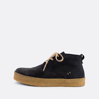 Casual chukka boots featuring navy blue suede uppers and natural crepe sole.