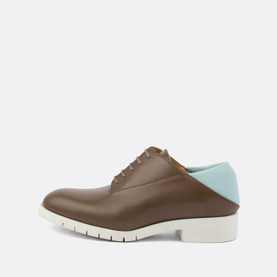 Brown leather derby shoes with a baby blue neoprene heel and off-white rubber sole.