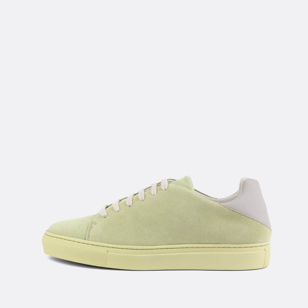 Casual sneakers in lime suede with contrasting lavender neoprene heel counter.