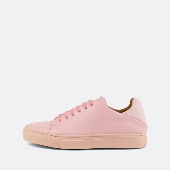 Casual sneakers in baby pink leather with neoprene heel counter.