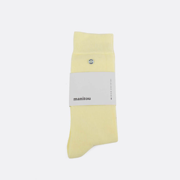 Pastel yellow soft socks.