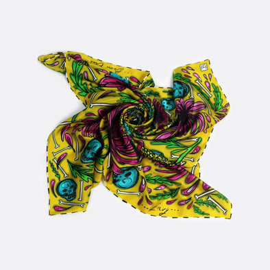 Yellow multicolor scarf with skulls, bones and flowers shapes.