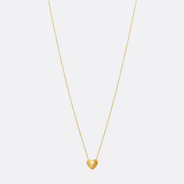 Golden heart necklace with pearl.
