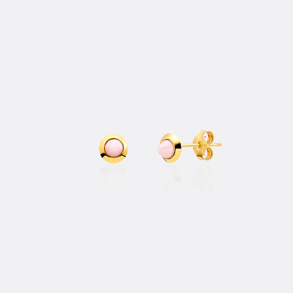 Golden earrings with pink gemstones.