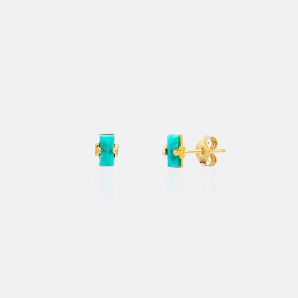 Golden earrings with blue rectangular gemstones.