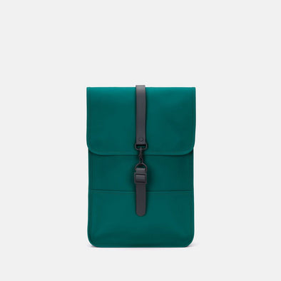 Boxy minimalist backpack in teal green synthetic with a single metallic black hook clasp