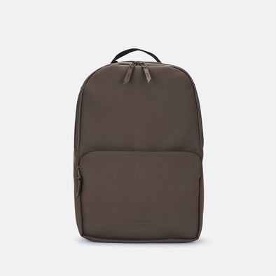 Minimalist daypack in brown synthetic with front pocket and matching zippers