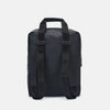 Minimalist boxy backpack in black synthetic with front pocket, matching zippers and handle