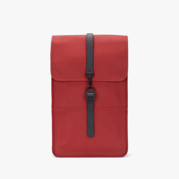 Boxy minimalist backpack in scarlet red synthetic with a single metallic black hook clasp