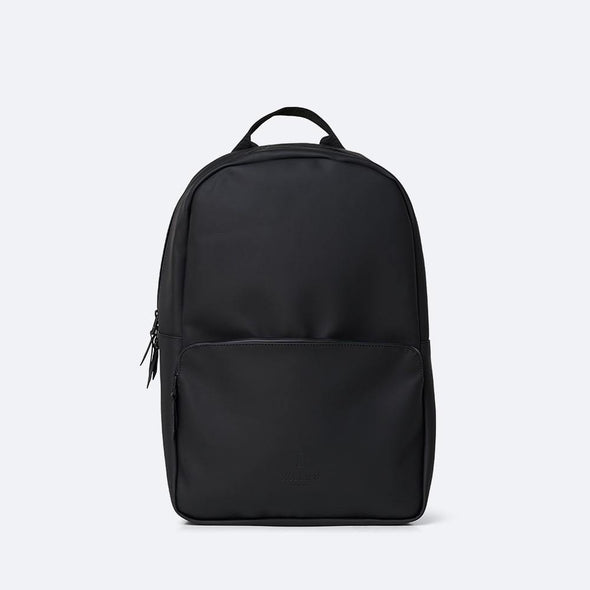 Minimalist daypack in black waterproof synthetic material.