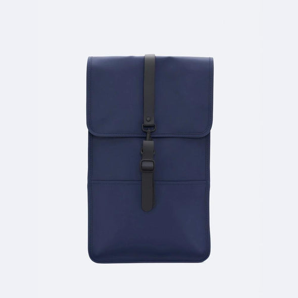 Minimalist backpack with a boxy design in navy blue waterproof synthetic material.
