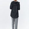 Black functional and unisex rain jacket with a casual fit, featuring an adjustable hood with a practical cap function.