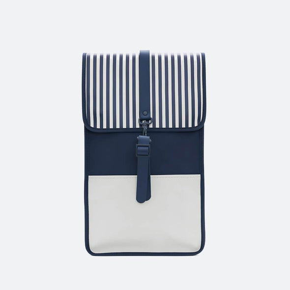 Minimalist backpack with a boxy design in navy blue and white waterproof synthetic material.