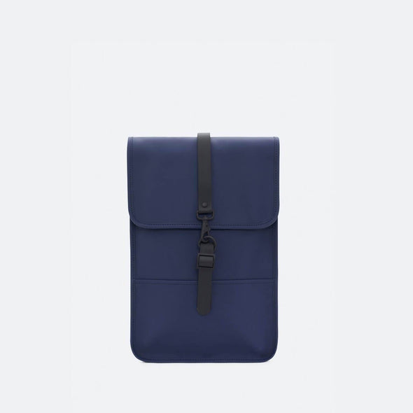 Minimalist backpack with a boxy design in dark blue waterproof synthetic material.