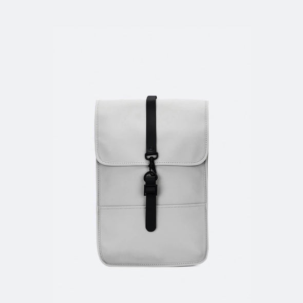 Minimalist backpack with a boxy design in stone grey waterproof synthetic material.