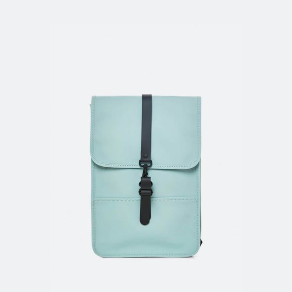 Minimalist backpack with a boxy design in dusty mint waterproof synthetic material.
