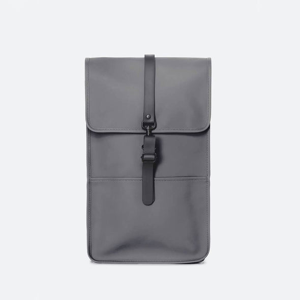 Minimalist backpack with a boxy design in grey waterproof synthetic material.
