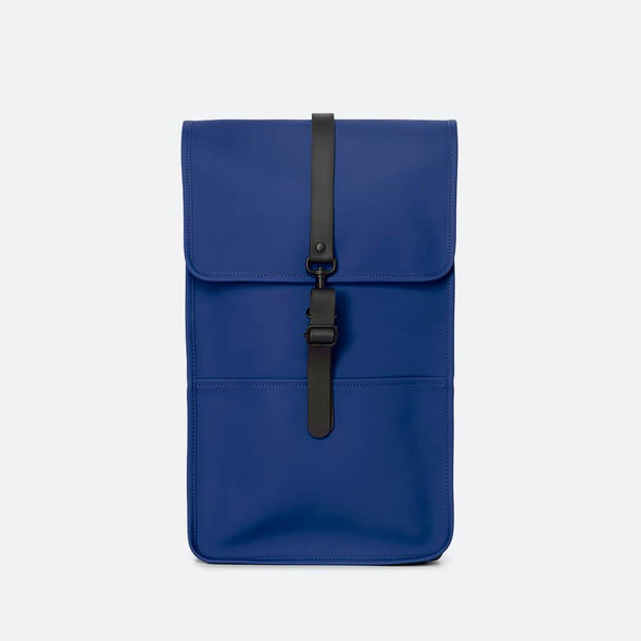 Minimalist backpack with a boxy design in klein blue waterproof synthetic material.